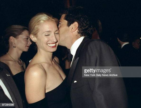 Carolyn Bessette Kennedy is amused by the whisperings of her husband John F Kennedy Jr at the Municipal Art Society gala at Grand Central Terminal...