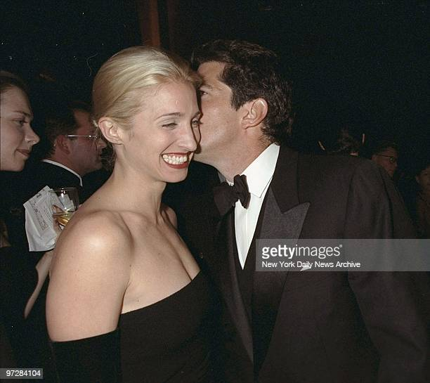 Carolyn Bessette Kennedy is amused by whisperings of her husband John F Kennedy Jr at the Municipal Art Society Gala at Grand Central Terminal...