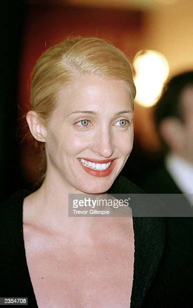 Carolyn Bessette Kennedy smiles for the cameras as she arrives at a benefit dinner New York City in the Fall of 1998