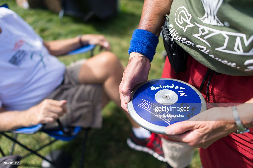 S Carolyn Bolander holds her discus on July 26 2013 while competing in the discus competitino at The National Senior Games A Tens machine attached to...