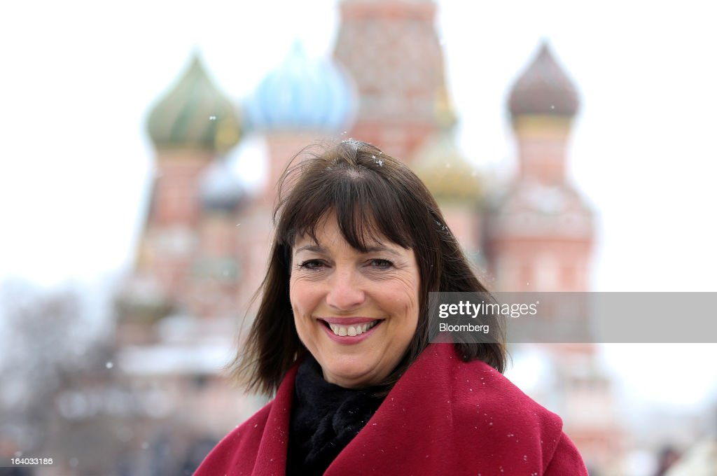 Carolyn McCall, chief executive officer of EasyJet Plc, poses for a photograph in Red Square near St. Basil's Cathedral in Moscow, on Tuesday, March 19, 2013. 'Moscow is a landmark route,' McCall said in a briefing before the departure of yesterdays inaugural flight to Russia, adding that bookings have generally exceeded expectations, with 'huge' and unanticipated demand for inbound tickets from Russia to the carrier's London base. Photographer: Chris Ratcliffe/Bloomberg via Getty Images