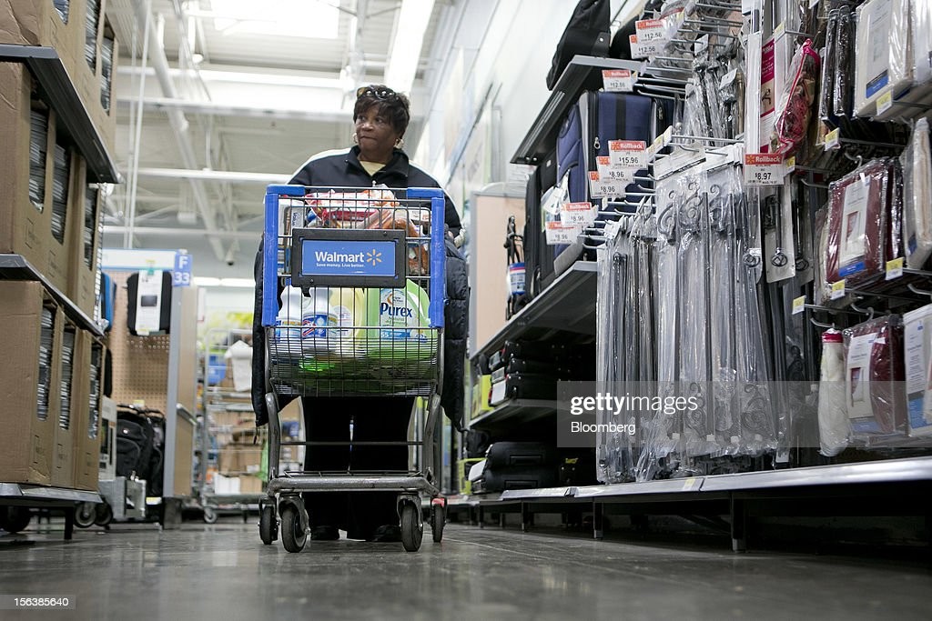 Carolyn Price pushes a shopping cart at a Wal-Mart store in Alexandria, Virginia, U.S., on Wednesday, Nov. 14, 2012. Wal-Mart Stores Inc. is scheduled to release earnings data on Nov. 15. Photographer: Andrew Harrer/Bloomberg via Getty Images