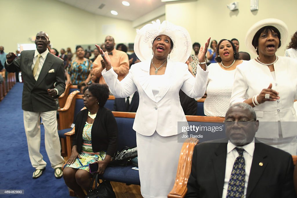 Carolyn Rivers and other parishoners respond to Reverend Al Sharpton as he speaks during a church service at Charity Missionary Baptist Church on...