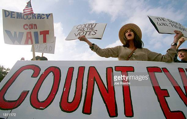 Carolyn Soling and other supporters of Vice President Al Gore hold signs December 10 2000 in front of the Governors mansion in Austin Texas The...