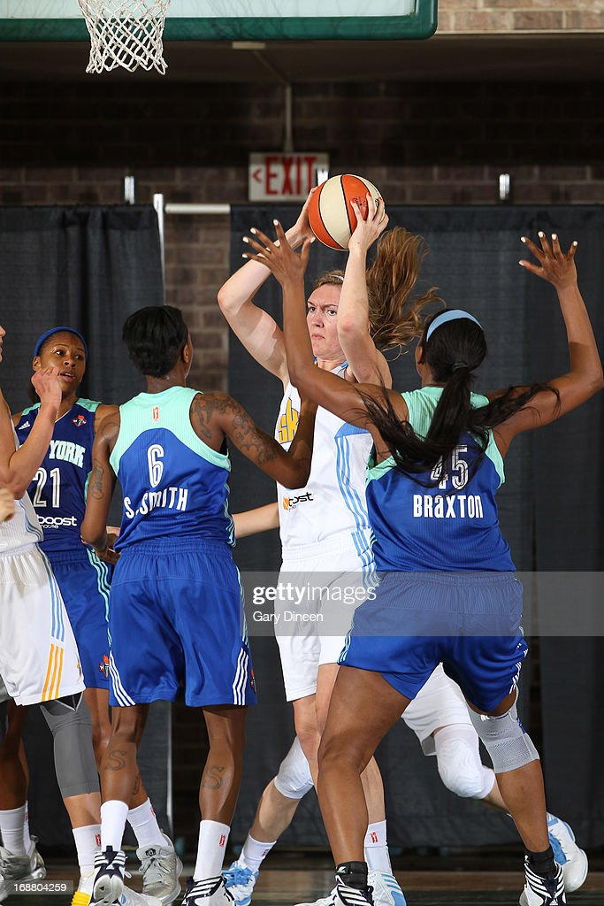 Carolyn Swords #30 of the Chicago Sky looks to pass while guarded by Shenneika Smith #6 and <a gi-track='captionPersonalityLinkClicked' href=/galleries/search?phrase=Kara+Braxton&family=editorial&specificpeople=226695 ng-click='$event.stopPropagation()'>Kara Braxton</a> #45 of the New York Liberty during the pre-season game on May 15, 2013 at the Jacoby D. Dickens Physical Education and Athletic Center on the campus of Chicago State University in Chicago, Illinois.