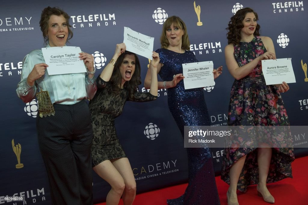 Carolyn Taylor, Meredith MacNeil, Jennifer Whalen and Aurora Browne ham it up with their name cards. Canadian Screen Awards red carpet at Sony Centre for the Performing Arts ahead of the show.