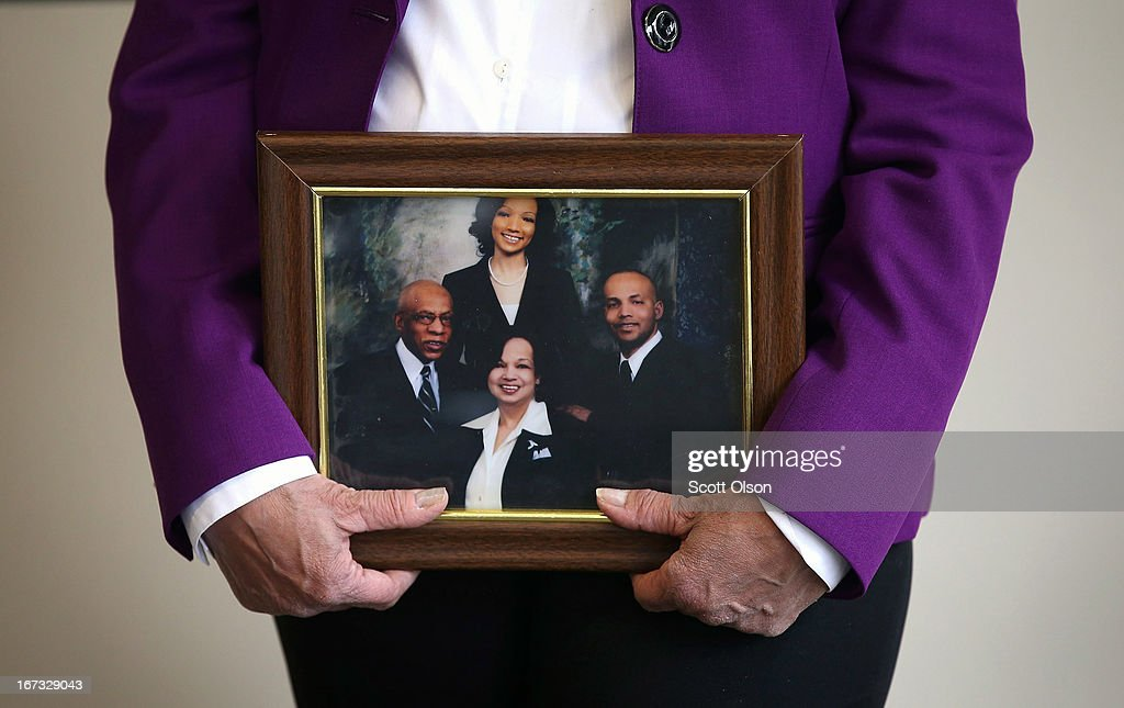 Carolyn Wortham holds a portrait of her, her husband retired Chicago police officerThomas Wortham III (L), her son Thomas (R) and daughter Sandra (rear) during a press conference where it was announced that the Brady Center to Prevent Gun Violence had filed a lawsuit on the Worthams' behalf against Ed's Pawn Shop and Salvage Yard in Byhalia, Mississippi on April 24, 2013 in Chicago, Illinois. The suit claims that the Worthams' son, Chicago Police officer and Iraq War veteran Thomas Wortham IV, was killed by a gun wrongfully sold to a straw purchaser at the pawn shop. Wortham IV was killed outside his parents' home on May 19, 2010 when 4 reported gang members tried to rob him of his motorcycle.