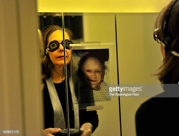 Carolyn Young with 'A Place for Mom' looks at herself in a bathroom mirror while wearing special goggles and other sensory altering devices as she...
