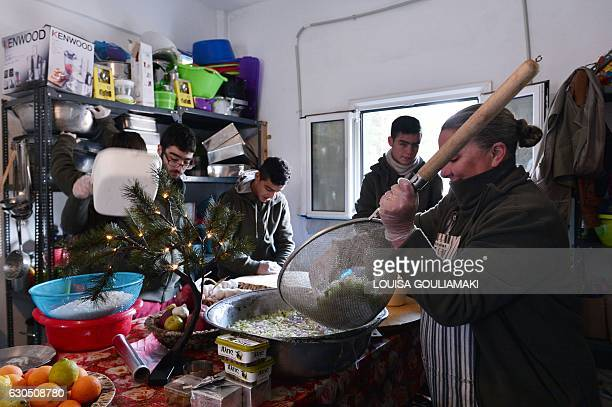 Carolynn Rockafellow and volunteers help chef Talal Rankoussi to cook a meal in the 'Cafe Rits' in Ritsona refugee camp some 80 km north of Athens on...
