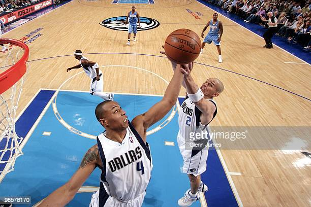 Caron Butler and Jason Kidd of the Dallas Mavericks go up for the rebound against the Denver Nuggets during the game at American Airlines Center on...