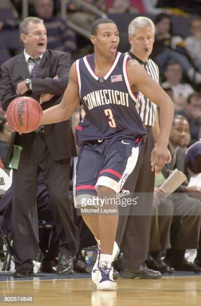 Caron Butler of the Connecticut Huskies dribbles the ball during the BBT College Basketball Classic game against the George Washington Colonials at...