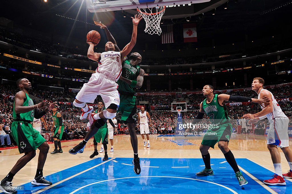 <a gi-track='captionPersonalityLinkClicked' href=/galleries/search?phrase=Caron+Butler&family=editorial&specificpeople=201744 ng-click='$event.stopPropagation()'>Caron Butler</a> #5 of the Los Angeles Clippers drives to the basket against <a gi-track='captionPersonalityLinkClicked' href=/galleries/search?phrase=Kevin+Garnett&family=editorial&specificpeople=201473 ng-click='$event.stopPropagation()'>Kevin Garnett</a> #5 of the Boston Celtics on December 27, 2012 at the Staples Center in Los Angeles, California.
