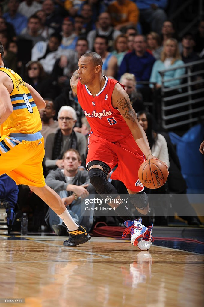 <a gi-track='captionPersonalityLinkClicked' href=/galleries/search?phrase=Caron+Butler&family=editorial&specificpeople=201744 ng-click='$event.stopPropagation()'>Caron Butler</a> #5 of the Los Angeles Clippers looks to drive to the basket against the Denver Nuggets on January 1, 2013 at the Pepsi Center in Denver, Colorado.