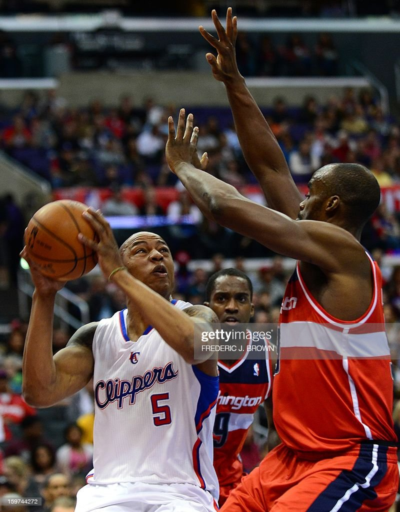 Caron Butler of the Los Angeles Clippers (#5) looks to shoot under pressure from Emeka Okafor (R) and Martell Webster (C) of the Washington Wizards during their NBA game in Los Angeles on January 19, 2013. AFP PHOTO / Frederic J. BROWN