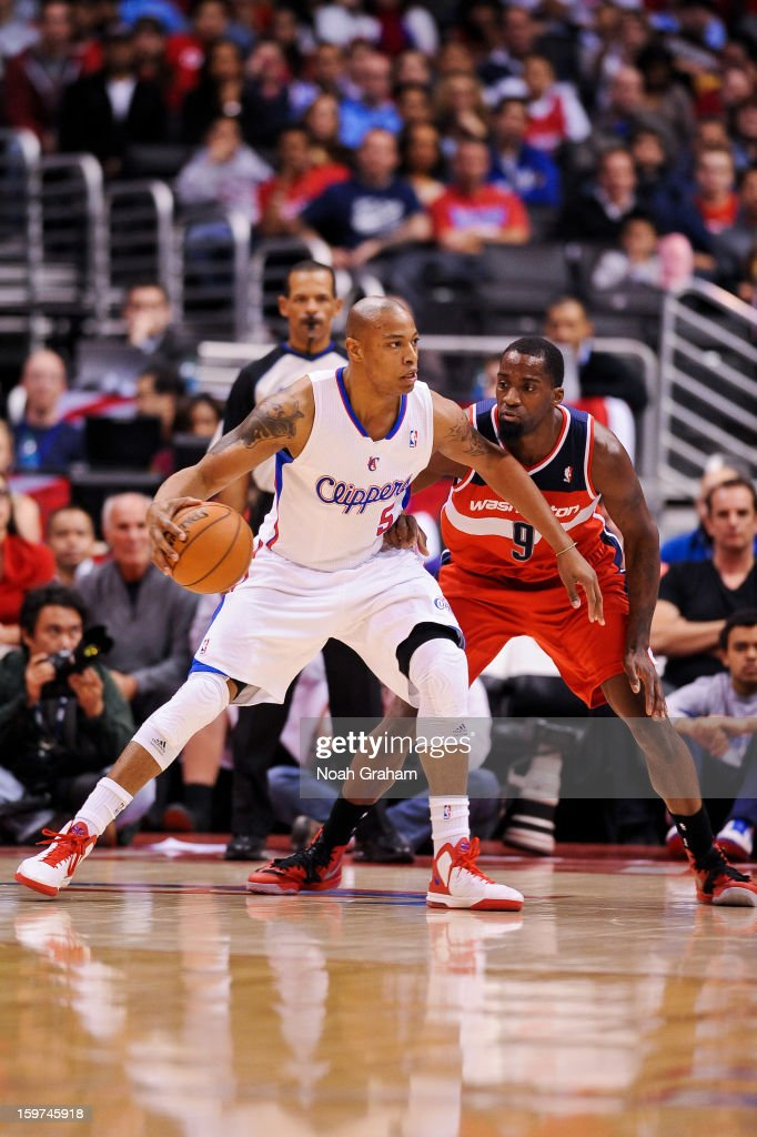 Caron Butler #5 of the Los Angeles Clippers posts-up against Martell Webster #9 of the Washington Wizards at Staples Center on January 19, 2013 in Los Angeles, California.