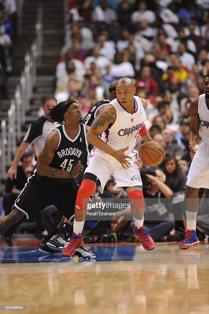 Caron Butler #5 of the Los Angeles Clippers protects the ball from Gerald Wallace #45 of the Brooklyn Nets during the game between the Los Angeles Clippers and the Brooklyn Nets at Staples Center on March 23, 2013 in Los Angeles, California.