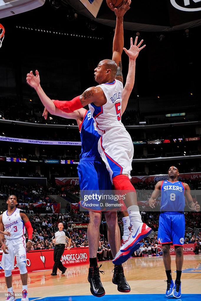 Caron Butler #5 of the Los Angeles Clippers rises for a dunk against Spencer Hawes #00 of the Philadelphia 76ers at Staples Center on March 20, 2013 in Los Angeles, California.