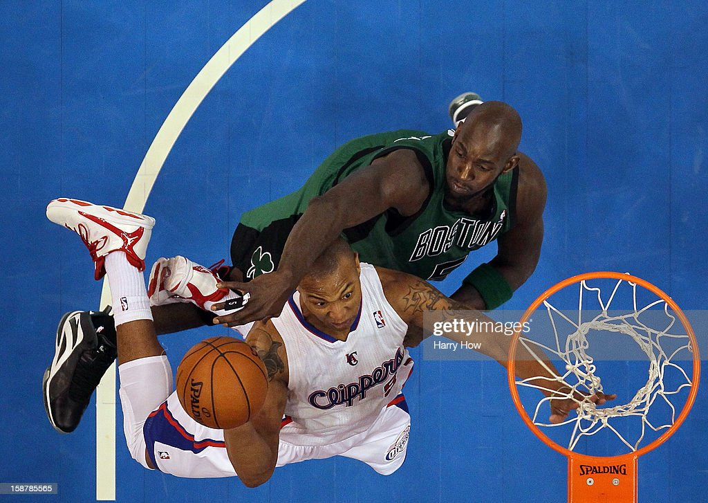 Caron Butler #5 of the Los Angeles Clippers scores on a layup as he is contested by Kevin Garnett #5 of the Boston Celtics during a 16-77 Clippers victory for 15 straight wins at Staples Center on December 27, 2012 in Los Angeles, California.