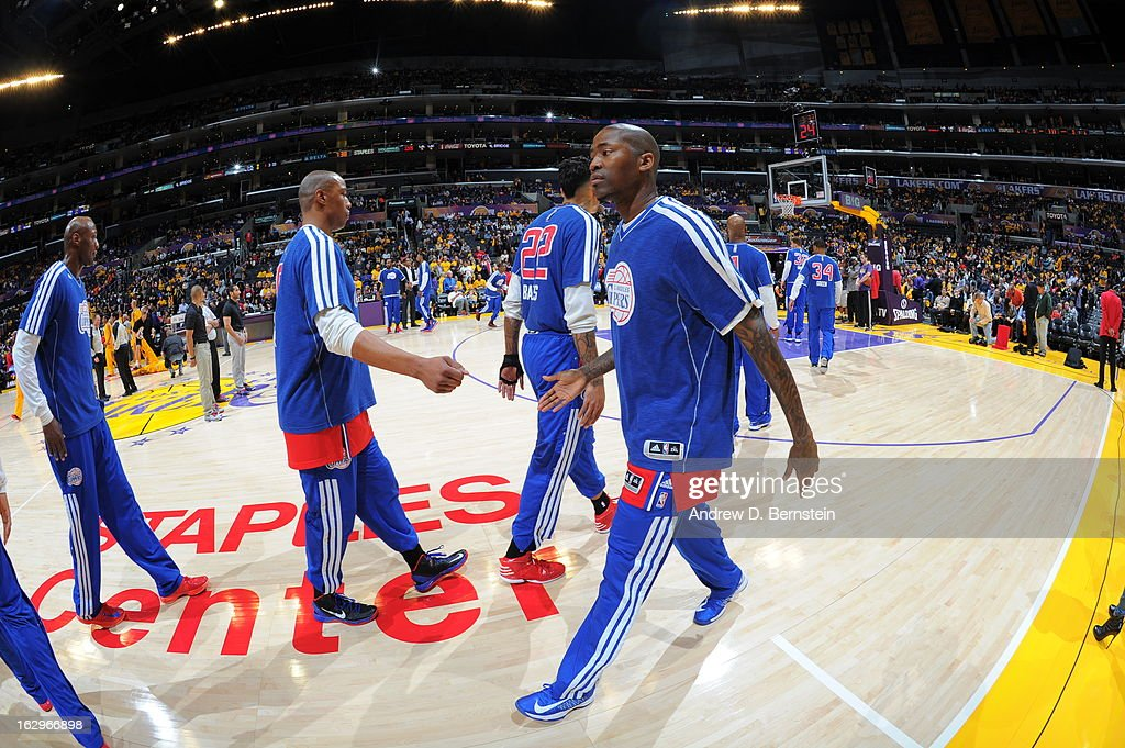 <a gi-track='captionPersonalityLinkClicked' href=/galleries/search?phrase=Caron+Butler&family=editorial&specificpeople=201744 ng-click='$event.stopPropagation()'>Caron Butler</a> #5 of the Los Angeles Clippers shakes hands with members of his team prior to the game against the Los Angeles Lakers at Staples Center on February 14, 2013 in Los Angeles, California.
