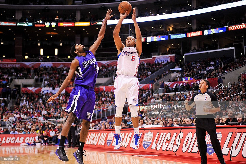 Caron Butler #5 of the Los Angeles Clippers shoots a three-pointer against John Salmons #5 of the Sacramento Kings at Staples Center on December 21, 2012 in Los Angeles, California.