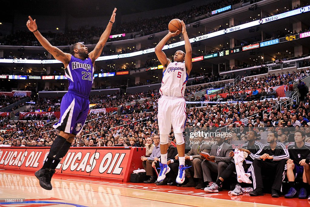 Caron Butler #5 of the Los Angeles Clippers shoots a three-pointer against Marcus Thornton #23 of the Sacramento Kings at Staples Center on December 21, 2012 in Los Angeles, California.