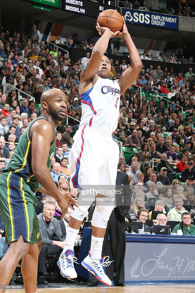 <a gi-track='captionPersonalityLinkClicked' href=/galleries/search?phrase=Caron+Butler&family=editorial&specificpeople=201744 ng-click='$event.stopPropagation()'>Caron Butler</a> #5 of the Los Angeles Clippers shoots against <a gi-track='captionPersonalityLinkClicked' href=/galleries/search?phrase=Jamaal+Tinsley&family=editorial&specificpeople=202203 ng-click='$event.stopPropagation()'>Jamaal Tinsley</a> #6 of the Utah Jazz at Energy Solutions Arena on December 28, 2012 in Salt Lake City, Utah.