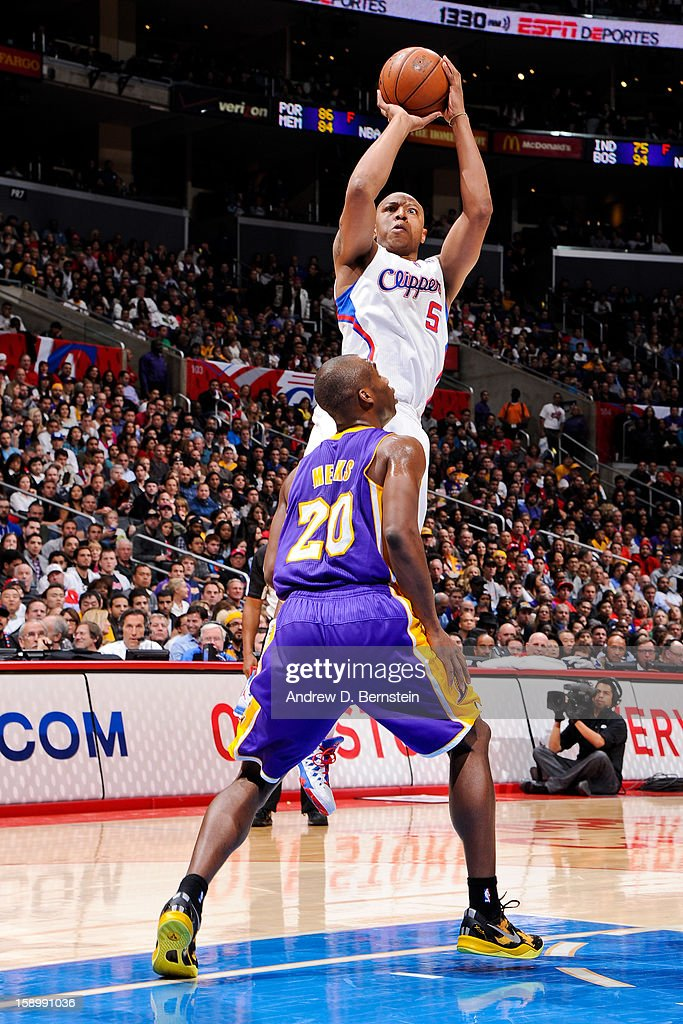Caron Butler #5 of the Los Angeles Clippers shoots against Jodie Meeks #20 of the Los Angeles Lakers at Staples Center on January 4, 2013 in Los Angeles, California.
