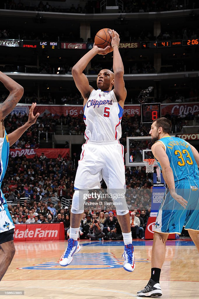 <a gi-track='captionPersonalityLinkClicked' href=/galleries/search?phrase=Caron+Butler&family=editorial&specificpeople=201744 ng-click='$event.stopPropagation()'>Caron Butler</a> #5 of the Los Angeles Clippers shoots against the New Orleans Hornets at Staples Center on December 19, 2012 in Los Angeles, California.