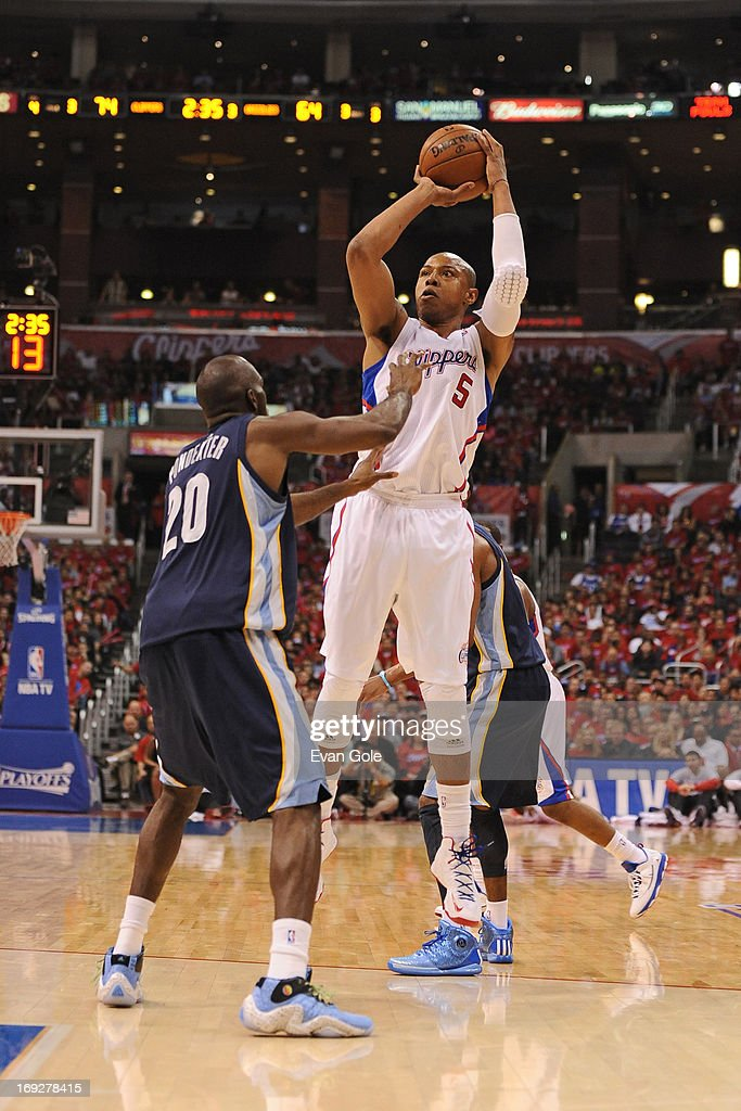 <a gi-track='captionPersonalityLinkClicked' href=/galleries/search?phrase=Caron+Butler&family=editorial&specificpeople=201744 ng-click='$event.stopPropagation()'>Caron Butler</a> #5 of the Los Angeles Clippers shoots the ball against the Memphis Grizzlies at Staples Center in Game One of the Western Conference Quarterfinals during the 2013 NBA Playoffs on April 20, 2013 in Los Angeles, California.