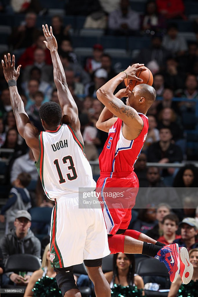Caron Butler #5 of the Los Angeles Clippers takes a shot against Ekpe Udoh #13 of the Milwaukee Bucks on December 15, 2012 at the BMO Harris Bradley Center in Milwaukee, Wisconsin.