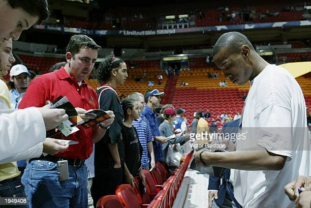 Caron Butler of the Miami Heat signs autographs before the game against the Washington Wizards at American Airlines Arena on April 11 2003 in Miami...