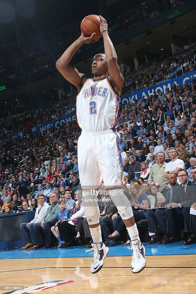 <a gi-track='captionPersonalityLinkClicked' href=/galleries/search?phrase=Caron+Butler&family=editorial&specificpeople=201744 ng-click='$event.stopPropagation()'>Caron Butler</a> #2 of the Oklahoma City Thunder takes a shot against the Houston Rockets during an NBA game on March 11, 2014 at the Chesapeake Energy Arena in Oklahoma City, Oklahoma.