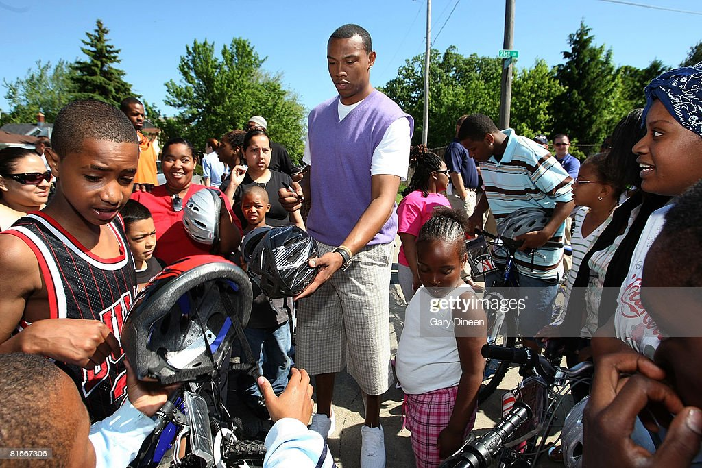 Caron Butler of the Washington Wizards autographs bike helmets during the 3rd Annual Butler's 3D Bike Brigade and Bike Ride on June 14, 2008 at Dr. John Bryant Community Center in Racine, Wisconsin.