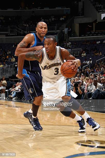 Caron Butler of the Washington Wizards drives past Shawn Marion of the Dallas Mavericks during the preseason game on October 9 2009 at the Verizon...
