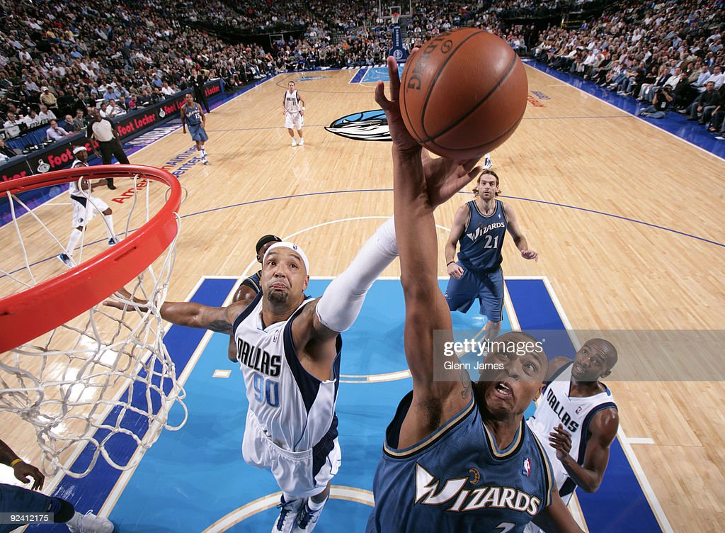 Caron Butler #3 of the Washington Wizards goes up for the rebound against Drew Gooden #90 of the Dallas Mavericks during the season opener at the American Airlines Center on October 27, 2009 in Dallas, Texas.