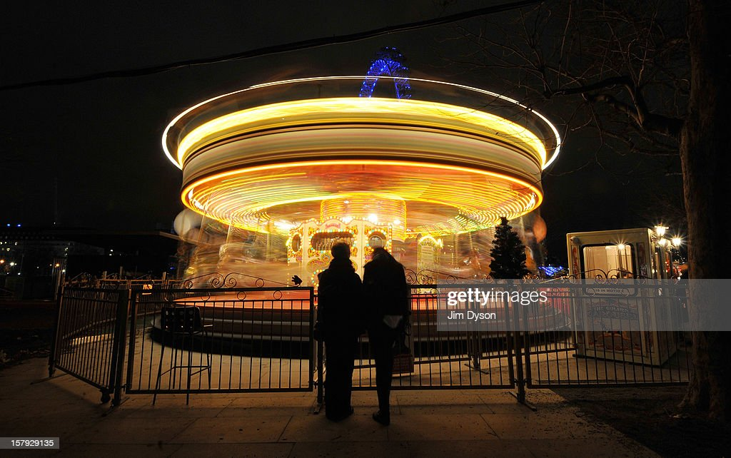 A carousel during a christmas market on the South Bank on December 7, 2012 in London, England. Eighty authentically decorated wooden chalets make up the Southbank Centre German Christmas Market as part of the Southbank's Winter Festival.