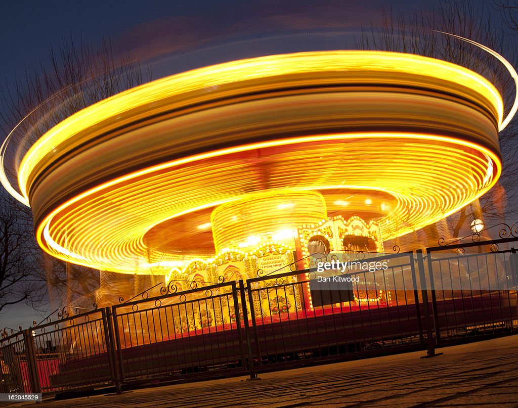 A carousel spins round on London's Southbank on February 18, 2013 in London, England.