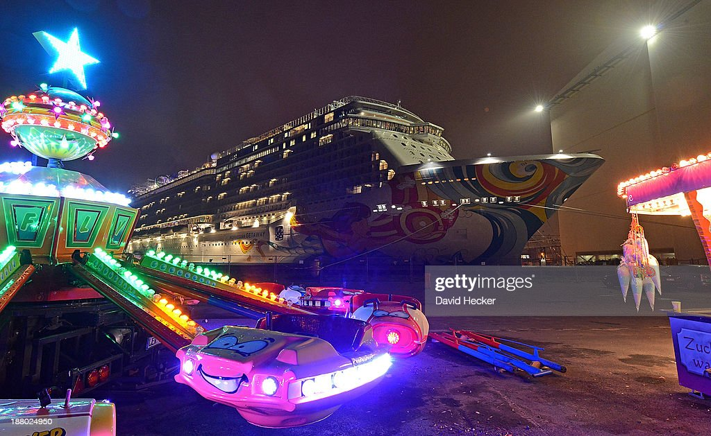 A carousel stands next to the Meyer Werft shipyard before the cruise of the Norwegian Getaway is towed down the Ems river by tugboat towards the...