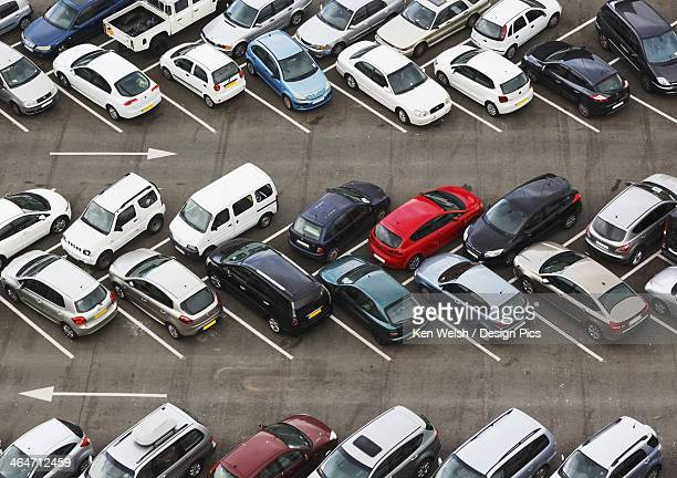 Carpark Viewed From Above With Cars Parked In Herringbone Pattern