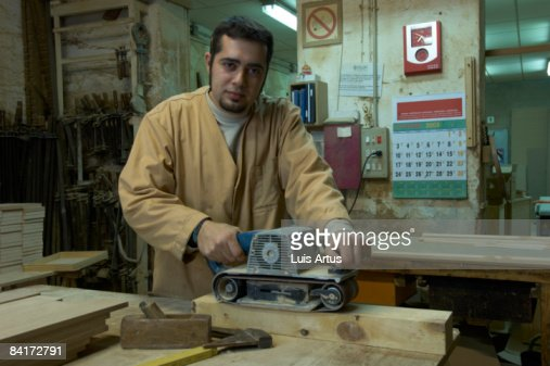 Carpenter at workstation : Stock Photo