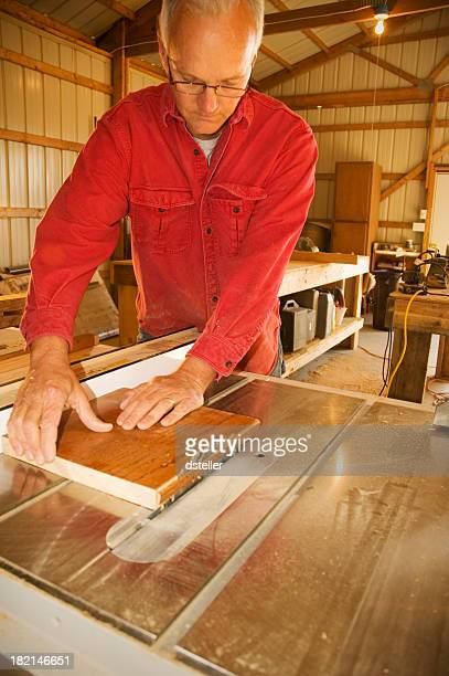 Carpenter Cutting a Board