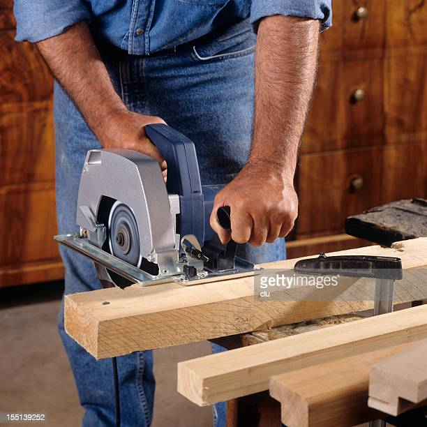 Carpenter cutting wood with buzzsaw