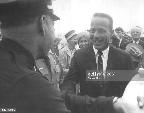 Carpenter greets old war time navy buddy now on Denver police force Police Lt Wayne Miller left was at airport as was Detective Tom W Dinsmore Credit...