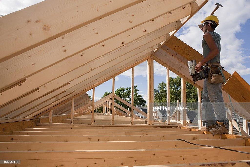 Carpenter hammering on roof rafters  Stock Photo & Carpenter Hammering On Roof Rafters Stock Photo | Getty Images memphite.com