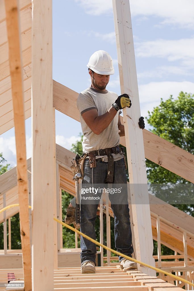 1 ... & Carpenter Using Safety Strap On The Roof Of A House Under ... memphite.com