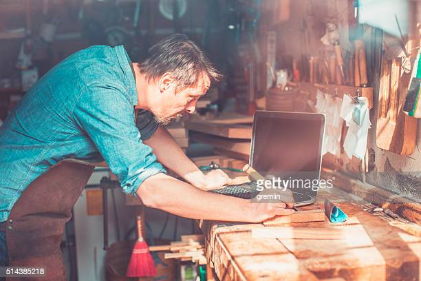 Carpenter in small workshop