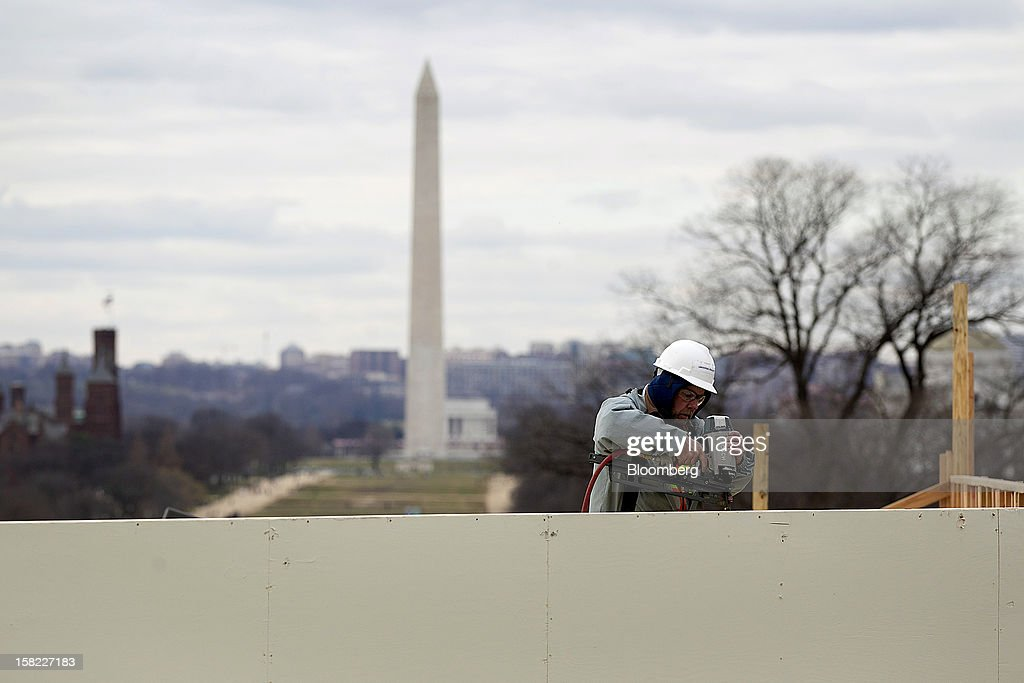 Carpenter Joe Martin works on the platform on the west front of the U.S. Capitol in preparation for the inauguration ceremony of U.S. President Barack Obama in Washington, D.C., U.S., on Tuesday, Dec. 11, 2012. The presidential inauguration ceremony will take place on Jan. 21, 2013. Photographer: Andrew Harrer/Bloomberg via Getty Images
