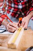Carpenter Measuring a Wooden Plank.  Close up.  Macro