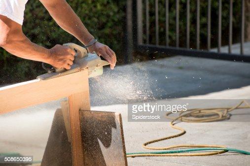 Carpenter Plaining Door : Stock Photo