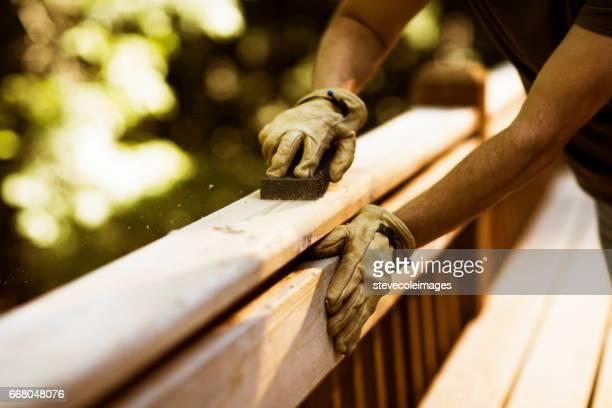 Carpenter Sanding Cedar Deck